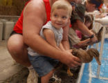 (PUEBLO, Colo., August 24, 2004) Colton,3, and his dad, Cole Anderson, Conifer, take a hold of...