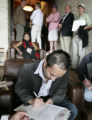 Patrick Wu, signs the deal after a winning  5.2 million dollar bid,  to win an auction for the...