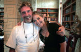 John McAfee hugs his partner Jennifer Irwin after his estate in Woodland Park sold to Patrick Wu,...