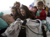 Fort Carson-based Staff Sgt. Matthew Keil is welcomed to Colorado by his sister-in-law Christine...