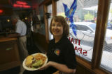 "Joan Colacci Riggins holds a ""wopburger"" in the Blue Parrot Italian Restaurant at 640..."