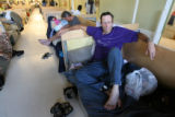 Charles Wesson, cq, of Chicago relaxes on his bed Thursday Mayl, 24, 2007 at the Salvation Army's...