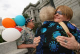 MJM232  Lisl Auman (cq), right, embraces Cindy Bell (cq), center, who is the aunt of prison inmate...