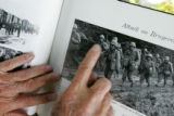 "86 year-old George T. Sakato (cq) points at a picture of himself, from a book called ""GO FOR..."