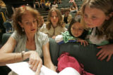 1135 Christy Berger, left, works with Denison Montessori student actors Sarah Berger, CQ, second...