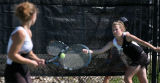 Annie Olson, Ft. Collins, lunges for the ball during her doubles match with Roxie Phillips, (left)...