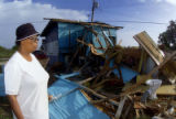 BRB101 - Jean Conliffe, 65, watches the demolition of her house, damaged by hurricane Ivan, in...