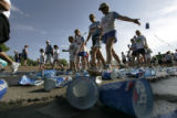 In the first mile of the run a cup of water is added to the many other discards along the route on...