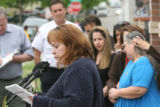 Julie Guzman (cq), the great aunt of 2 year-old Jose Mathew Jauregui (cq), speaks to members of...