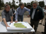Matt Sugar (cq), left, asks United States Congressman Mark Udall to sign a poster of the Rocky...