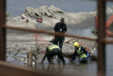 0289 A Denver Fire rescue team shows investigators where they removed the body of Jose Matthew...