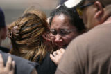 0333 Elsha Guel, mother of Jose Matthew Jauregui Jr., and unidentified family members support each...