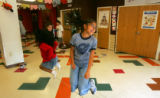 Estrella Guerrero (cq), 9, of Thornton, laughs while jumping rope at the after school program at...