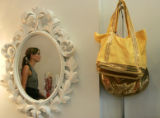 Owner  of True Love - shoes and accessories- Sarah  Lilly 9 (cq) reflected in the mirror is a new...