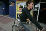 Veta pedals down the sidewalk with Joe in front of HiDrive as we look at life on two blocks of...
