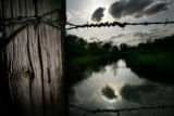 MJM113 A barbed wire fence separates property near the Republican River Tuesday evening 5/15/07 in...