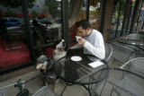 Avi Meyer (cq) of Den. at coffee shop  with his two dogs Sophie (st bernard) and Buck (Aust....