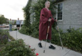 Tyler Carron (CQ), 18, practices walking unassisted outside his families Berthoud home Wednesday...