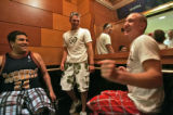 Nikko Landeros,left, Kyle Carron, middle, and Bruce Carron, far right in mirror, laugh as Tyler...