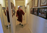 Tyler Carron (CQ), 18, practices walking unassisted down the hallways of his families Berthoud...