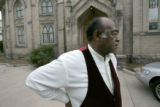 0065 Rev. Acen Phillips arrives for bible study at the New Birth Temple of Praise Community...