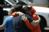 0112 Family members comfort each other at the scene where Jose Matthew Jauregui Jr. was found dead...