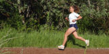 ** Special for the Rocky Mountain News** Distance runner Melody Fairchild works out at the Amazon...