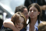 0308 Elsha Guel, center, mother of Jose Matthew Jauregui Jr., is comforted by unidentified family...