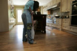 Hannah Butler, 3 plays with her mom Erin Butler in their kitchen in Denver, Colo.on Wednesday, May...