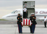 The Marine Honor Guard carries the casket of U.S. Recon Marine Sgt. Nicholas Walsh, 26, to the...