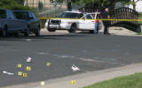 Aurora Police investigate a homicide scene at 19th Ave. and Chester Street Friday morning May...