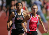 Sarah Cocco, of Fairview, right, runs the anchor leg of the 5A girls' 3200m relay state track...