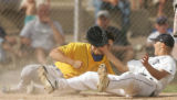 (sequence 1) Wheat Ridge's Donnie Bauer draws his arm back to punch Columbine pitcher Kyler Brady,...