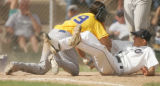 (sequence 3) Wheat Ridge's Donnie Bauer appears to punch Columbine pitcher Kyler Brady, right,...