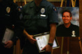 MJM152  Aurora Police officers stand with awards in front of a photo of slain Aurora Police...