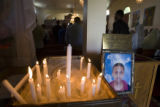 DLM6822  Funeral candles burn next to a photograph of Yacob Gezaee during a funeral service for he...
