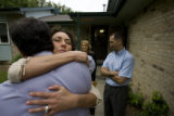 DLM6361  Brenna Gabel Simmons hugs attorney Joe Batuello after he met with her family regarding...