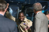 Barrington Irving (cq) greets officials after landing in a helicopter to meet with 500 Aurora...