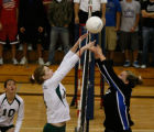 Mountain vista's #14 Sarah Miller (l) bumps up against Highlands Ranch #5 Bri Smith in the 3rd...