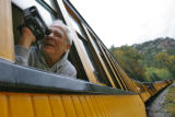 DM3885  John Lahm, 66, of Santa Maria, Calif. leans out the window to record the views from the...