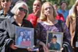 Stephanie O'Bryan (cq) holds a photo of her niece, Kimberly Greene Medina (cq) and Michelle Martin...