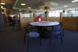 Ms.  Willis edits her work in progress in the cafeteria at the student union on campus at UNC...