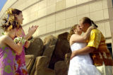 05/18/2004 DENVER, COLO.-Newlyweds Matt and Mallory Capraro kiss as their daughter, Victoria...