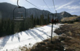 Skiiers ride up the Exhibition lift, to mid- mountain at Abasin Wednesday morning October 10,...