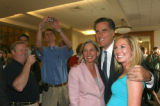 Presidential candidate, Matt Romney, center, has his photo taking with former Colorado Firsts...