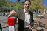 David Moesteller (cq) with one of the homeless parking meters he has sponsored at his Paradise...