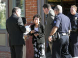 Police investigate talk to a woman, at a shooting at the 3rd Avenue Market, 300 Elati, Wednesday...
