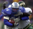 PHoto by Jerilee Bennett-Saturday., November 11,2000-Air Force's fullback Nate Beard runs carries...