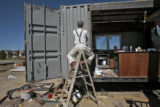 Erik Bonnett (cq) helps prepare the kitchen section of the University of Colorado Solar Decathlon...