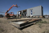 A work crew prepares the kitchen section of the University of Colorado Solar Decathlon home for...